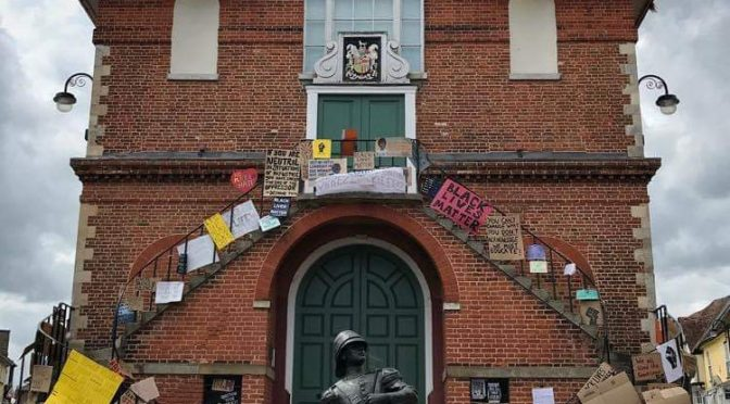 The ancient Shire Hall in Woodbridge Suffolk UK which has been decorated with BLM posters
